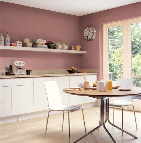 rose walls and creamy cabinets create a very chic combo and a strong girlish feel in the space
