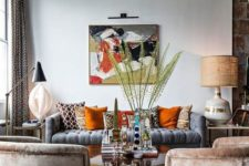 02 this bright and interesting living room got a couple of fall touches with orange and beige pillows