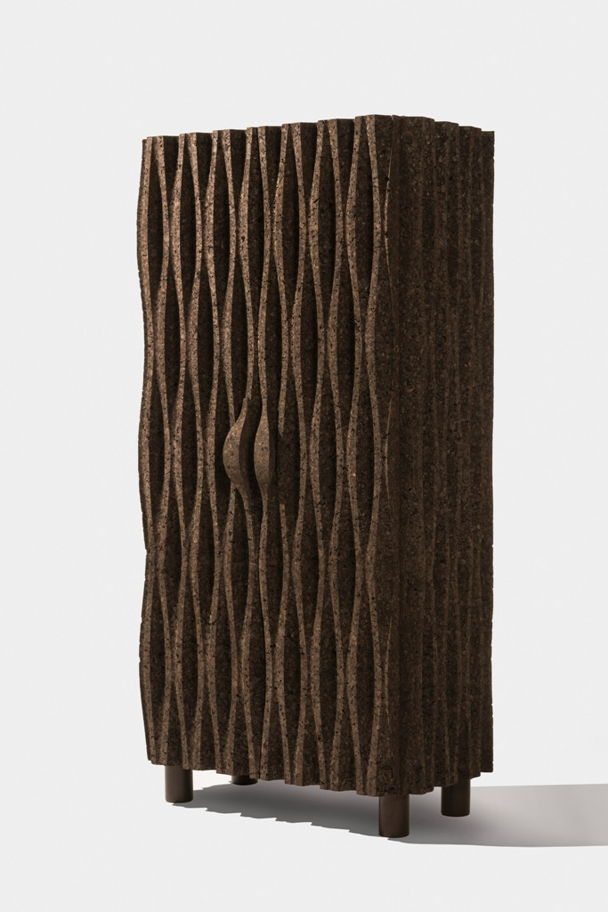 Here's one of the cabinets of dark cork that shows off cool wave-like design