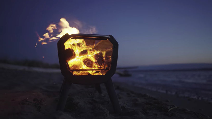 Mesh used for design allows watching the fire and foldable legs make it easy to port