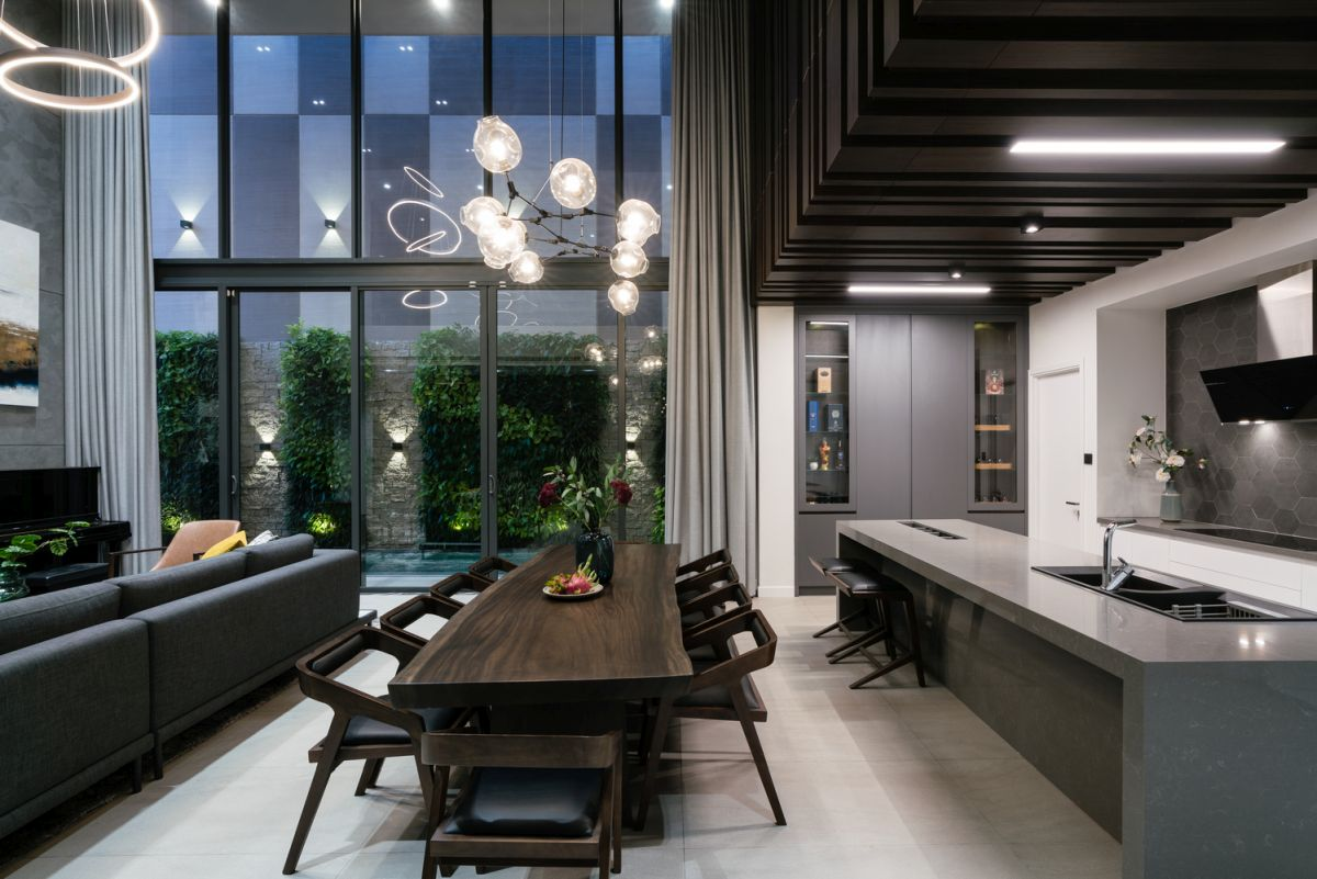 The dining area is next to the minimalist kitchen