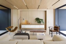 03 The interiors are done in a neutral color palette, with much wood and plywood, and dark touches add depth to the decor
