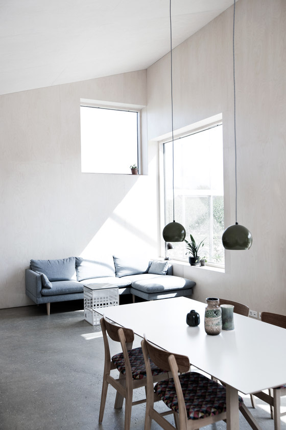 The living space is also here, with a blue sofa by the window to catch more sunlight