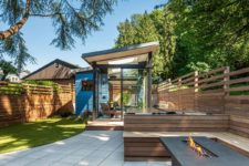 03 The shed is clad with glass and wood and is opened to the backyard
