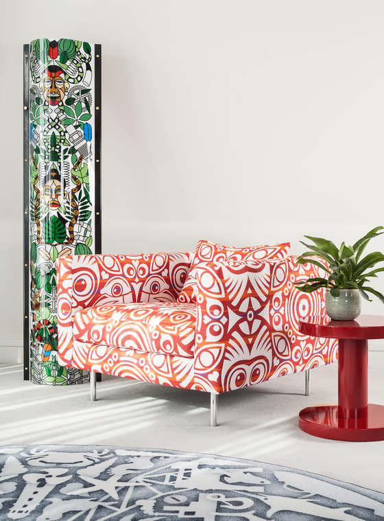 The spaces are spruced up with bright upholstered furniture inspired by Dutch designs