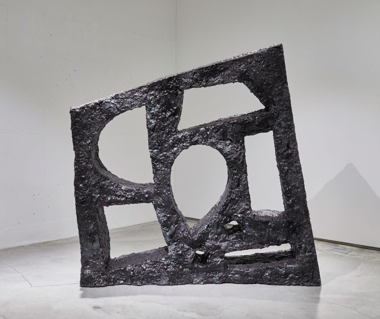This crazily looking meteorite piece is a bookshelf