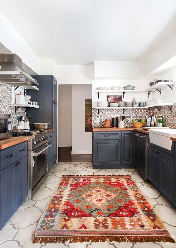 a boho rug and a mosaic tile backsplash make a grey kitchen boho and folksy