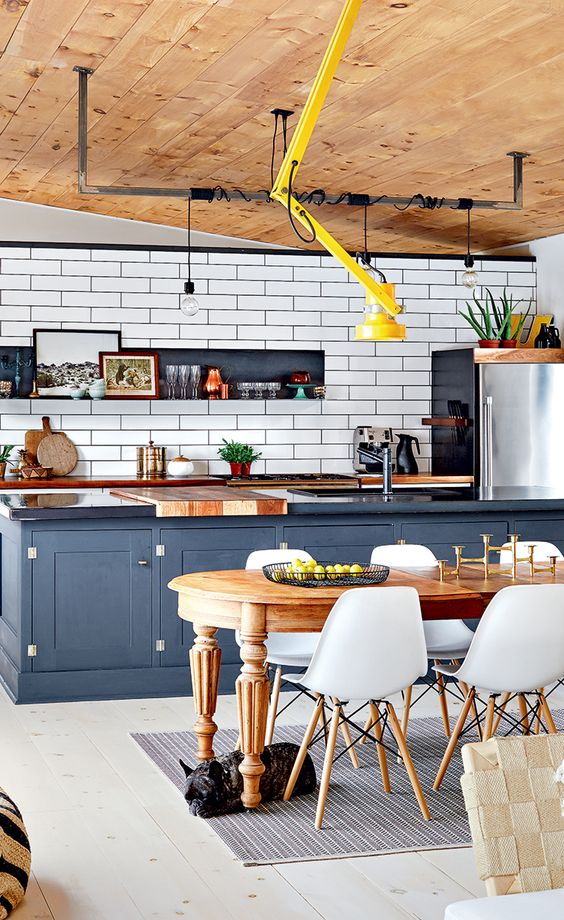 a kitchen island separates the kitchen and the dining space