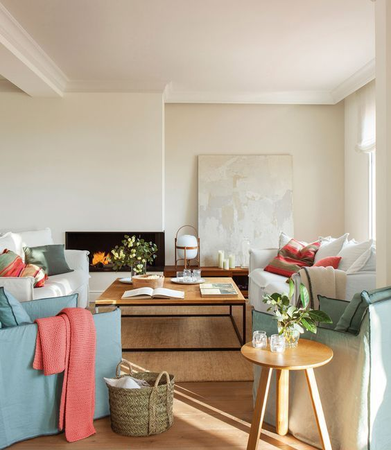 a neutral living room done with mint and coral accents will never fail