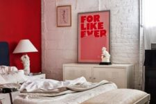 03 a red accent wall is a bold statement in this white and off-white bedroom and an artwork matches