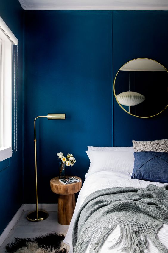 bold blue walls make a statement and look very chic with gilded touches