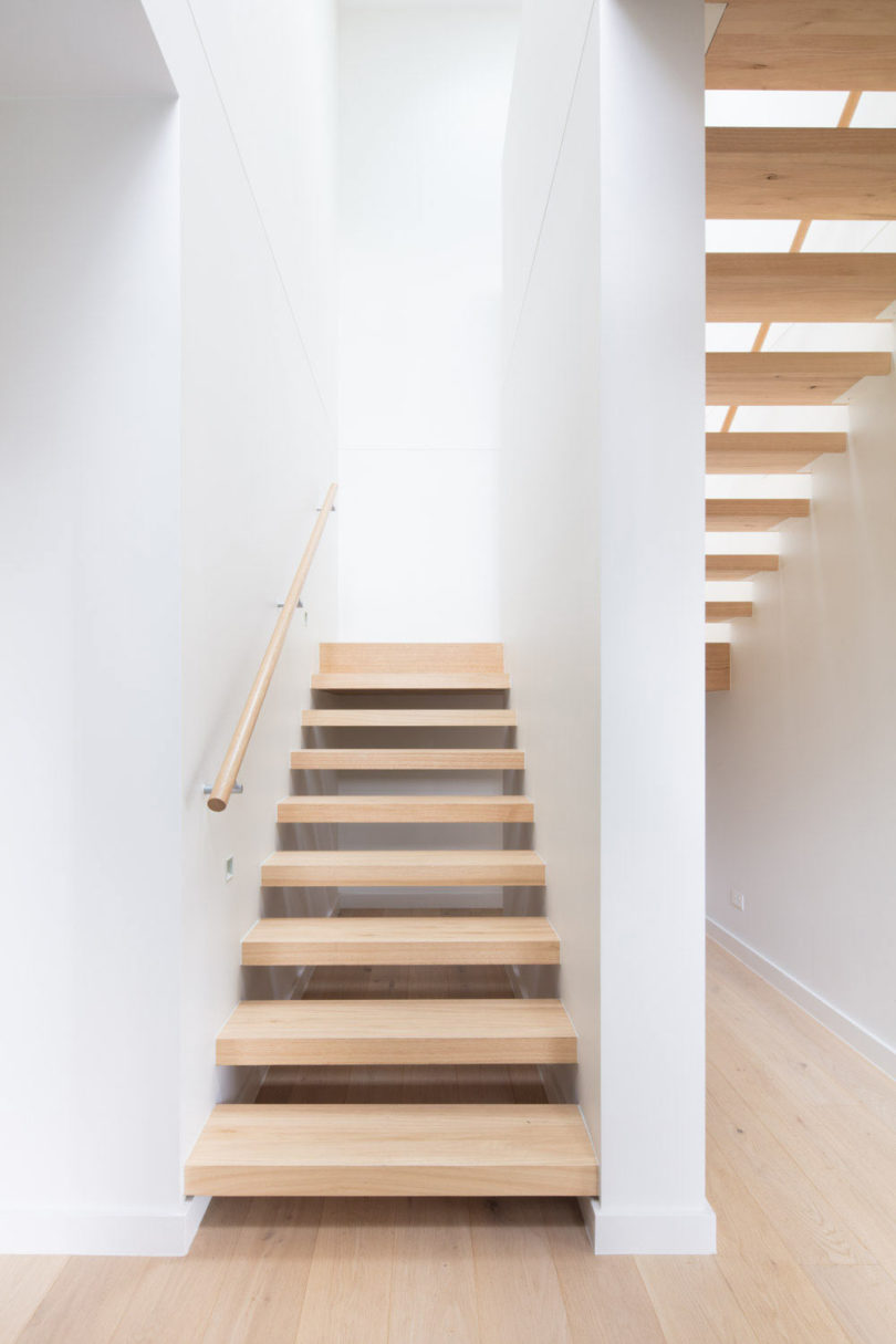The stairs are floating ones, done of light colored wood