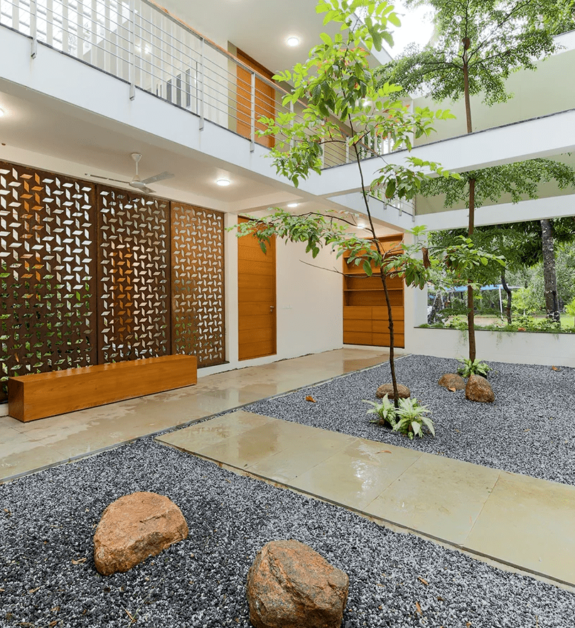 The two halves of the building are connected with an inner courtyard with stones and trees growing