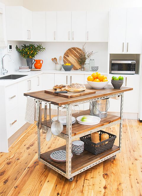 a mobile industrial kitchen island of metal and wood with two shelves and hooks and holders for an edgy touch