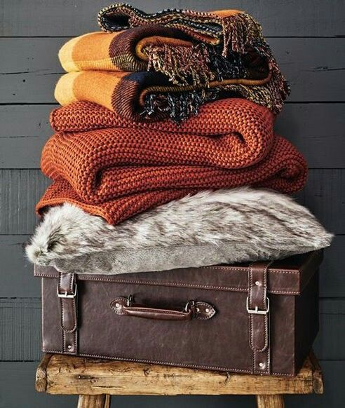 add some knit and usual blankets in the fall shades - rust, orange, brown