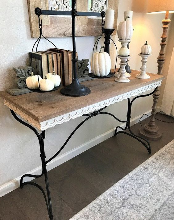 vintage console styling, white pumpkins on scales and stands and vintage books