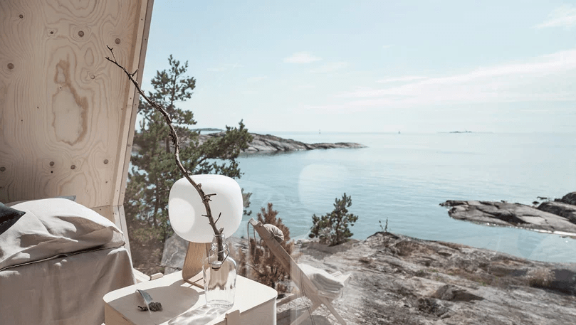 The furniture and lamps are Scandinavian and simple, nothing here distracts from the views