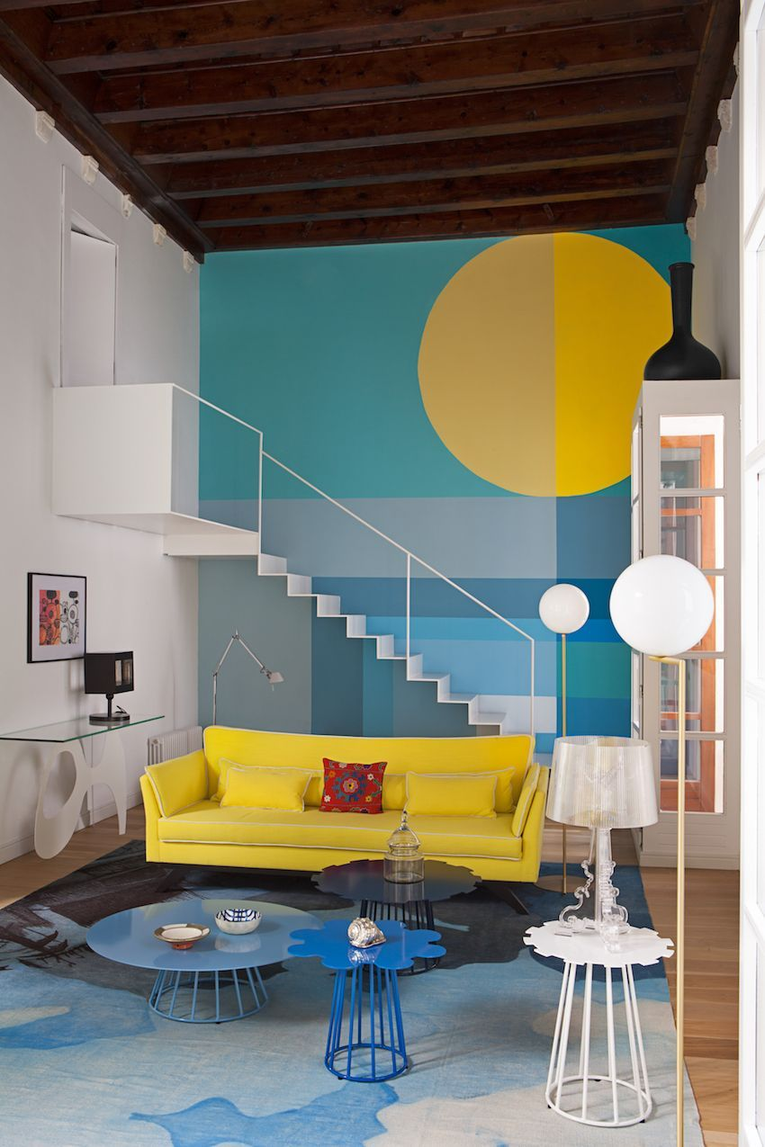 The living room is a vibrant space done in the shades of blue and yellow