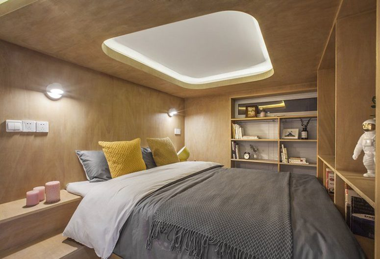 The sleeping box contains a bedroom and built-in shelves and cabinets