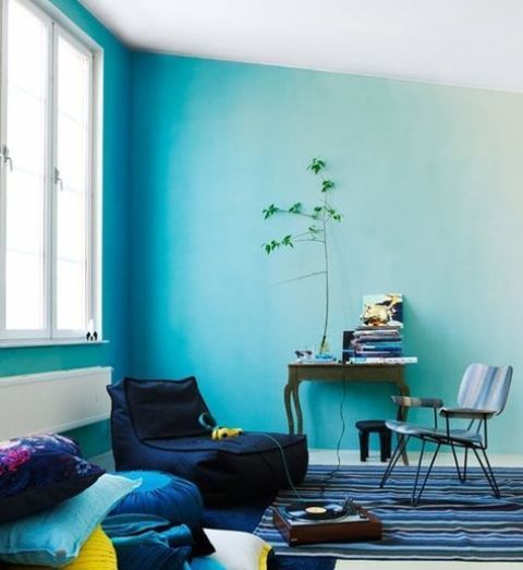 a bright living room with light blue as a dominant color and navy as an additional one