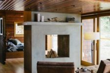 05 a concrete clad fireplace isn't only a space divider here but also a focal point that provides coziness