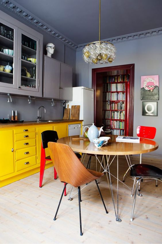 a moody space done in grey, with yellow as the secondary color and red for bold accents