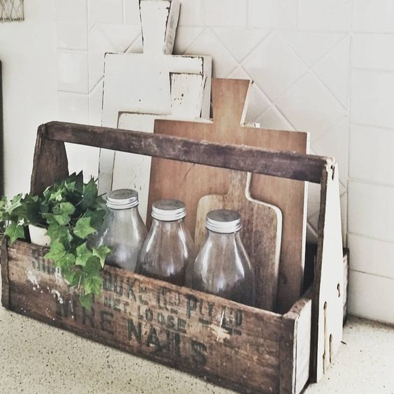 a rustic kitchen will look nice with a caddy made of an old too box with some stenciling