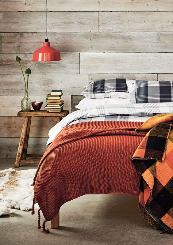 blankets in fall colors are an easy and budget-friendly way to make your bedroom fall-like