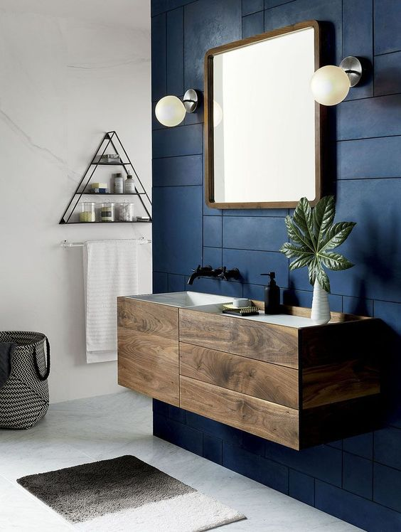matte navy panels on the sink wall brings a bold and masculine feel to this contemporary bathroom