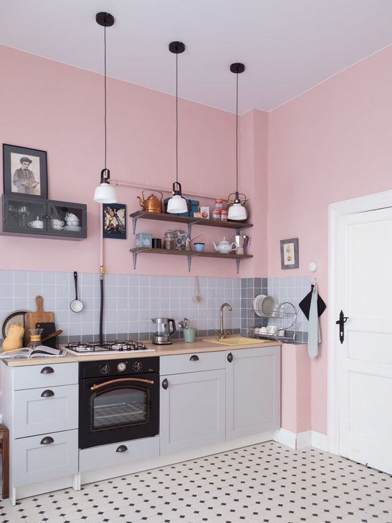 pink walls and shades of grey are a perfect combo for any kitchen and black touches add depth