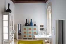 06 The second part of the living room is calm and peaceful, with a vintage cabinet and artworks