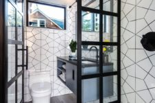 06 There's a small mudroom with white tiles, a floating vanity and small windows