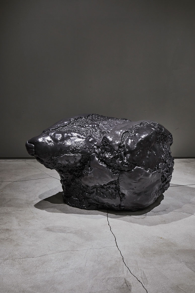 This black foam chair or seat looks like a real meteorite