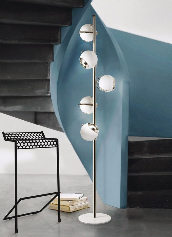 a chic mid-century floor lamp with a metal base and little spheres is a great idea for a hallway