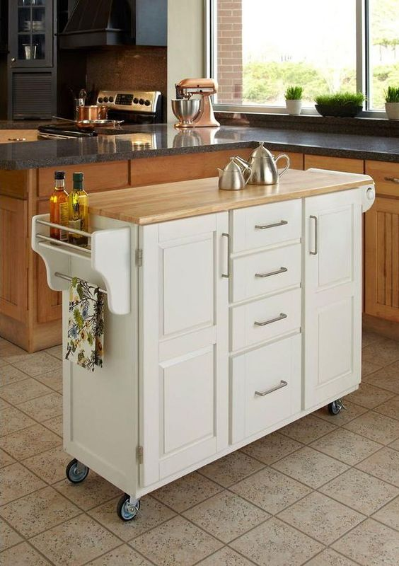 A Comfy Mobile Kitchen Island With Many Drawers And Holders Plus A Wooden  Countertop