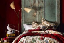 06 a deep red statement wall and a matching bedspread add color and interest to the room