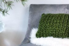 06 a faux fur throw and a chunky knit pillow add texture and coziness to the space