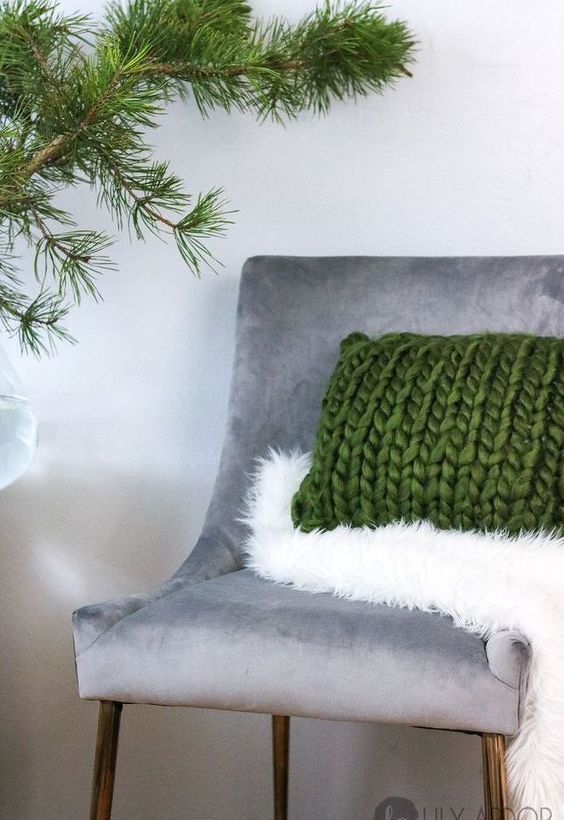 a faux fur throw and a chunky knit pillow add texture and coziness to the space