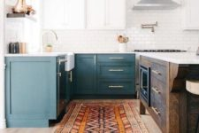 06 a two-toned kitchen in teal and white plus a dark-stained kitchen island to add a rustic touch