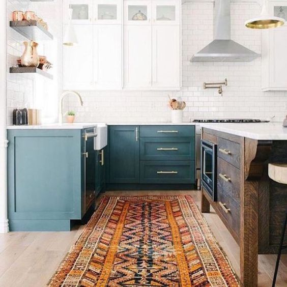 a two-toned kitchen in teal and white plus a dark-stained kitchen island to add a rustic touch