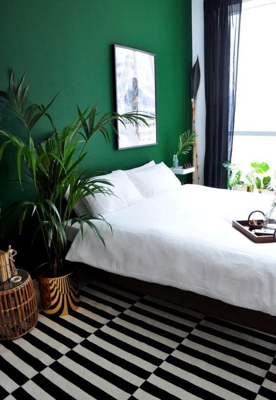 an emerald accent wall will refresh the bedroom and add color to the space