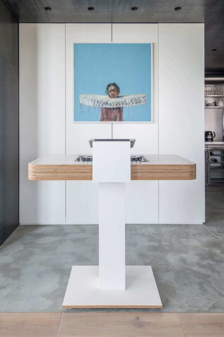 Here's a DJ stand for havign parties and an accent of a bold artwork