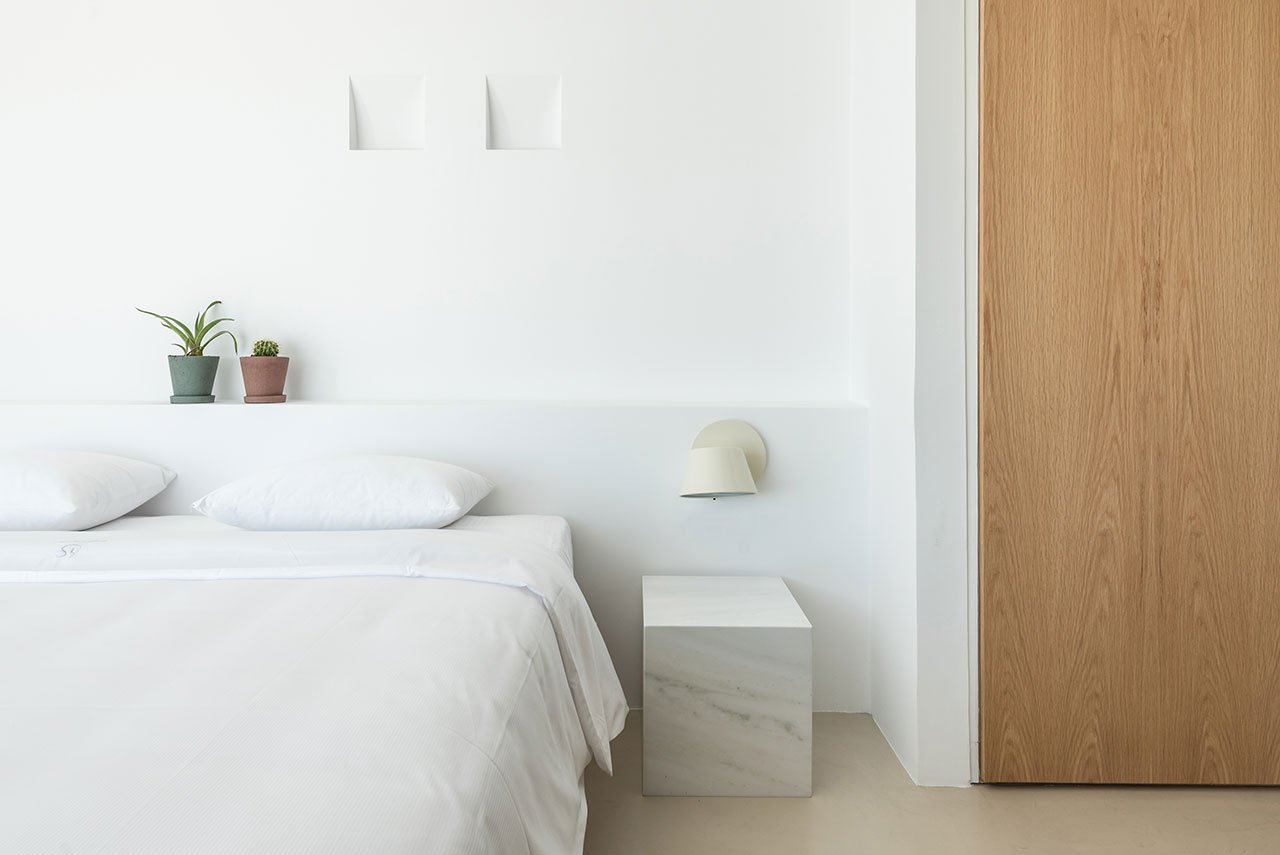 The bedroom is spruced up with marble and touches of natural wood