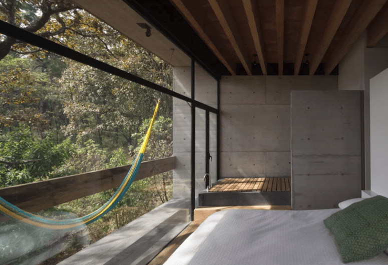 The master bedroom includes a bathtub and a balcony with a hammock to relax as much as possible