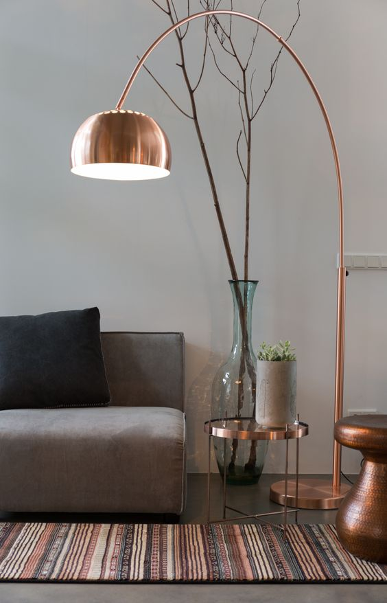 a copper floor lamp with a long leg is sure to make a stylish statement and add a trendy touch with its metallic look