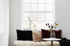 07 a cozy nook with a blush, plum and black velvet pillow, faux fur and a dried floral arrangement is a truly fall space
