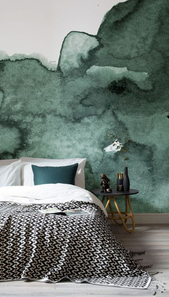 a dark green watercolor accent wall is a great statement in this bedroom, add a matching piece like a pillow here