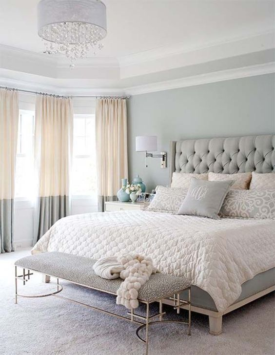 a grey bedroom with touches of cream looks very soft and subtle and makes you feel relaxed