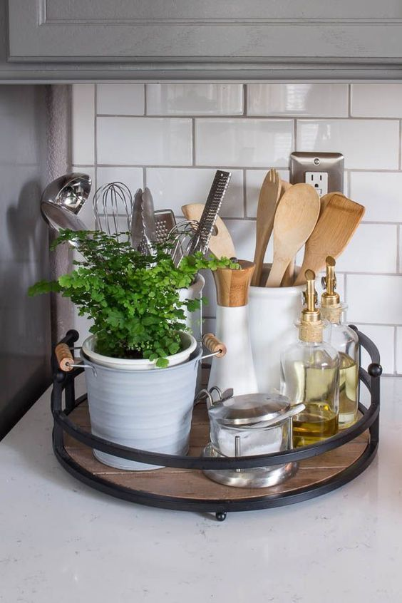a stylish modern kitchen caddy with black metal framing and a wooden bottom
