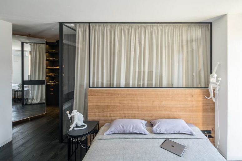 The master bedroom is a large space made up of four parts, a bedroom, a bathroom, a closet and an office